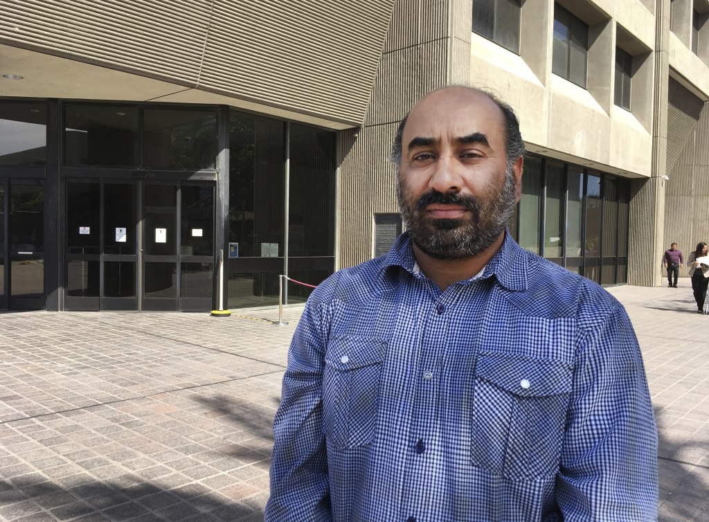 Gurmukh Singh arrives for his immigration check-in outside the Immigration and Customs Enforcement's offices in Santa Ana, Calif. on Monday, May 8, 2017. Singh, a taxi driver originally from India, has been detained by U.S. immigration authorities during a check-in for an 18-year-old deportation order. (AP Photo/Amy Taxin)