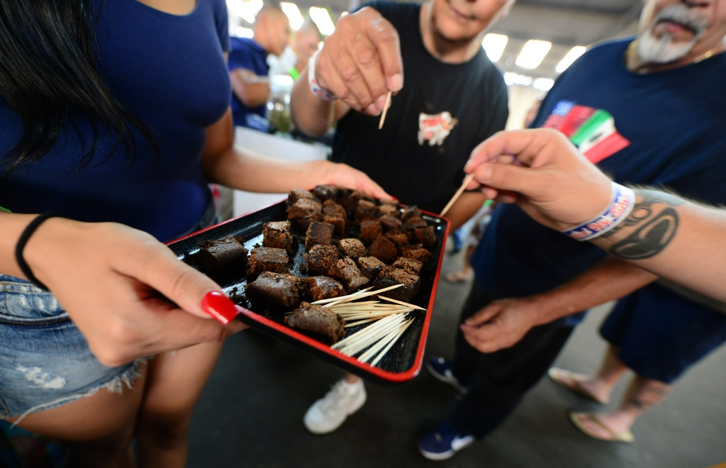 Care-carrying medical marijuana patients sample the brownies at Los Angeles' first-ever cannabis farmer's market at the West Coast Collective medical marijuana dispensary, on the fourth of July, or Independence Day, in Los Angeles, California on July 4, 2014 where organizer's of the 3-day event plan to showcase high quality cannabis from growers and vendors throughout the state.