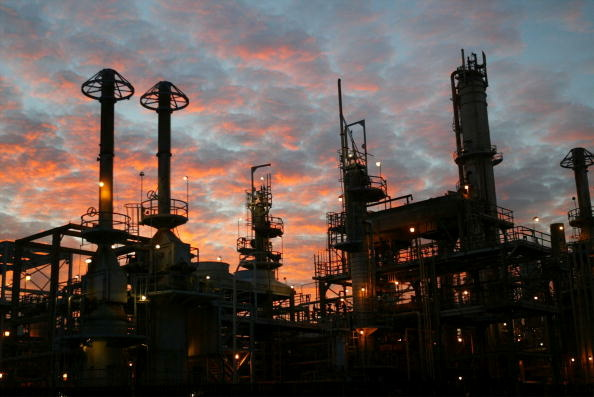 The Wilmington ARCO refinery is seen before dawn on December 19, 2003 in Los Angeles, California. Wilmington is a modest, blue-collar section of Los Angeles dotted by thousands of oil wells and home to three of California's major oil refineries.