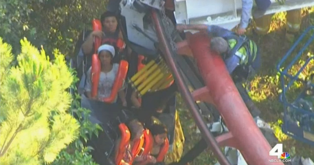 Four people were injured and about two dozen others stranded late Monday after the Ninja coaster slightly derailed. All riders were removed after about three hours.