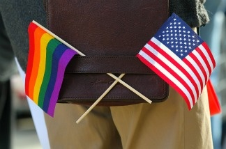 A gay pride and an American flag hang from a shoulder bag during a demonstration outside of the Phillip Burton Federal Building on June 13, 2011 in San Francisco, California.