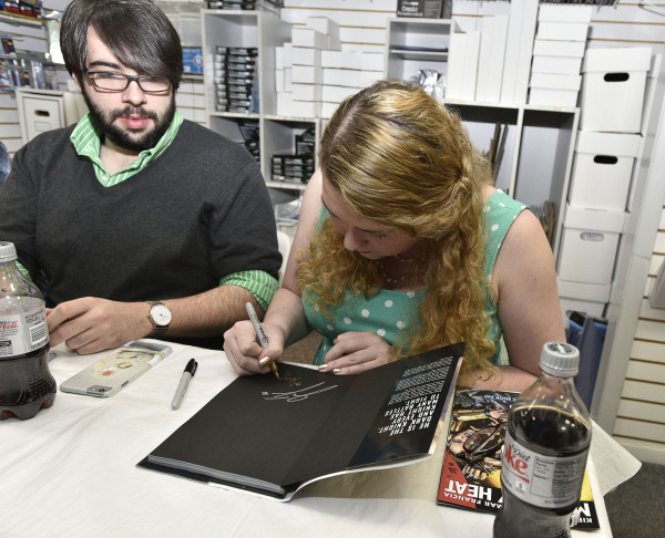 File: Joe and Kristy Isenbergh, of Boston, browse a selection of free comics at Newbury Comics in Boston, Saturday, May 5, 2012.