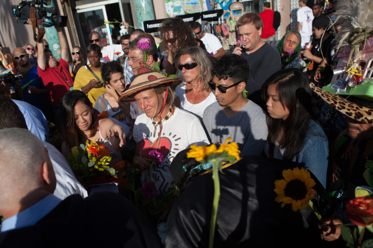 Venice residents participate in a vigil for the victims of a runaway driver that sped through the Venice Boardwalk on Saturday.