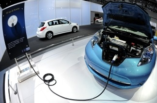 The Nissan Leaf electric is seen charging during the press day of the LA Auto Show in Los Angeles, California.