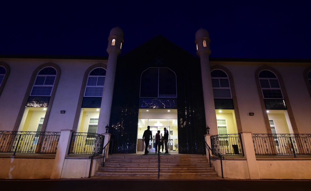 People arrive at the Ahmadiyya Muslim Community in Chino, California on December 3, 2015, for prayers at the Baitul Hameed Mosque to commemorate lives lost a day after the tragedy in San Bernardino.