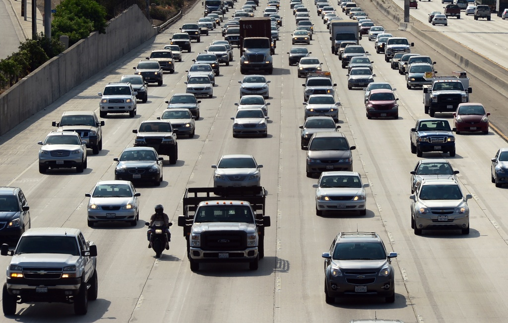 Motorists make their way out of downtown Los Angeles headed east on the Interstate 10 freeway on August 30, 2013.