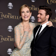 "Actors Lily James (L) and Richard Madden (R) arrive at the premiere of Disney's ""Cinderella"" at the El Capitan Theatre on March 1, 2015 in Los Angeles, California."
