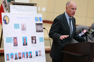 California Attorney General and Democratic candidate for governor Jerry Brown speaks during a news conference August 31, 2010 in Oakland, California. Attorney general Brown announced that law enforcement officers had arrested key members of the Nuestra Familia gang who had orchestrated crimes from inside prison using cell phones. Brown called for a solution to end the use of contraband cellular phones inside prisons.