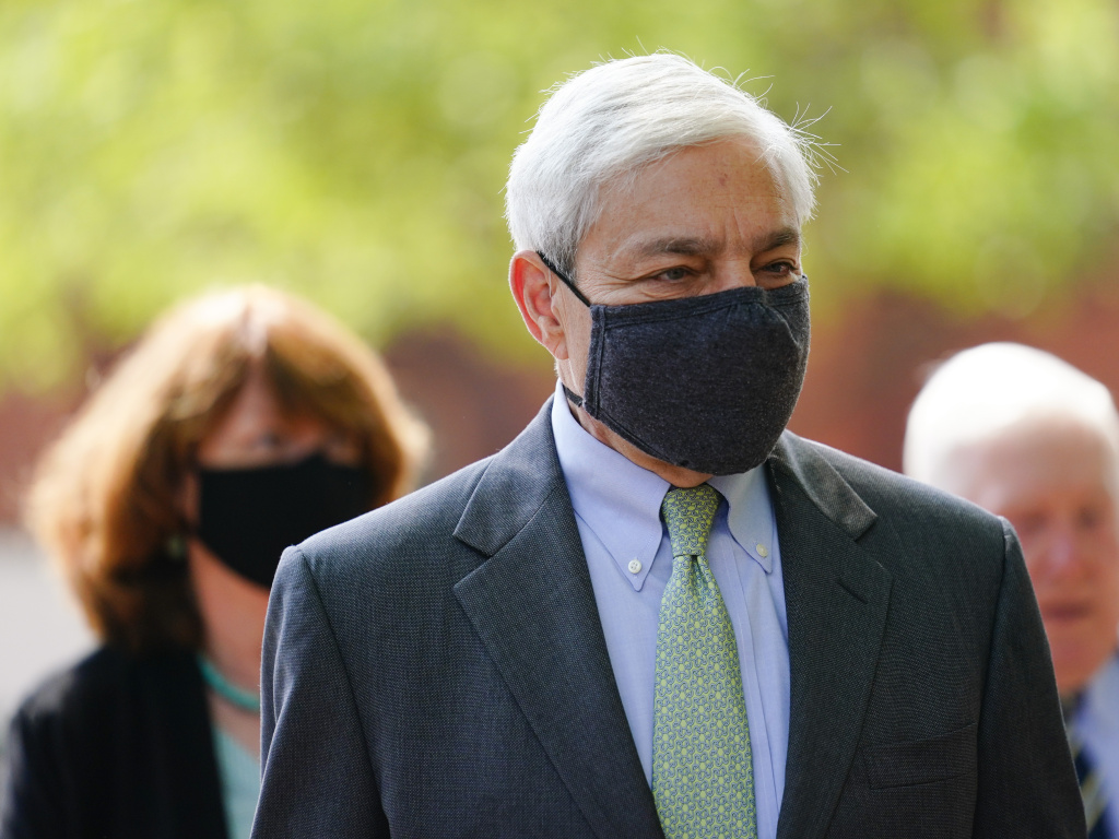 Former Penn State President Graham Spanier walks from the Dauphin County Courthouse in Harrisburg, Pa., after a hearing on Wednesday. A judge said Spanier must report to jail on July 9 to begin serving at least two months for endangering the welfare of children.