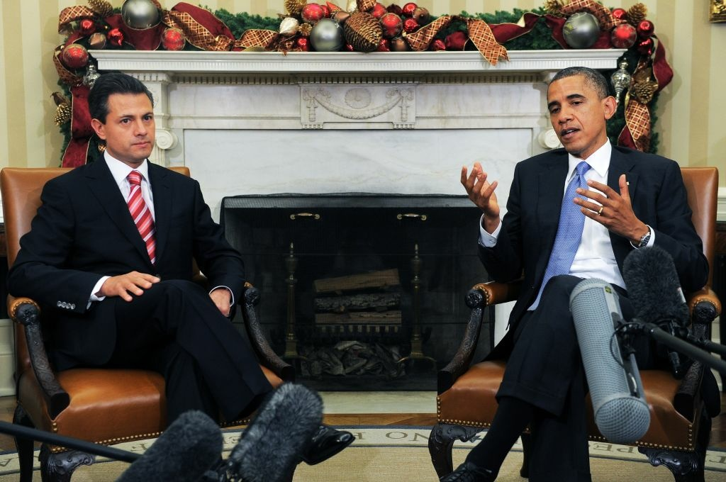 US President Barack Obama speaks tyo the press with President-elect Enrique Pena Nieto of Mexico during a bilateral meeting in the Oval Office at the White House in Washington on November 27, 2012. Pena Nieto, a member of the Institutional Revolutionary Party (PRI), takes office on December 1, replacing Felipe Calderon from the conservative National Action Party (PAN), five months after his election victory.