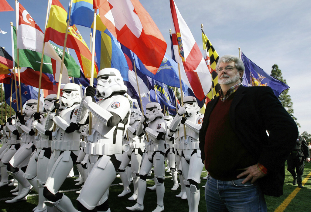 FILE - In this Dec. 31, 2006, file photo, Star Wars director George Lucas, reviews members of the 501st Legion, a group of Star Wars fans dressed as storm troopers, as they march in a rehearsal for their entry in the 118th Rose Parade, in Pasadena. Lucas is visiting a galaxy on the edge of downtown Los Angeles to break ground on his $1.5 billion Lucas Museum of Narrative Art.