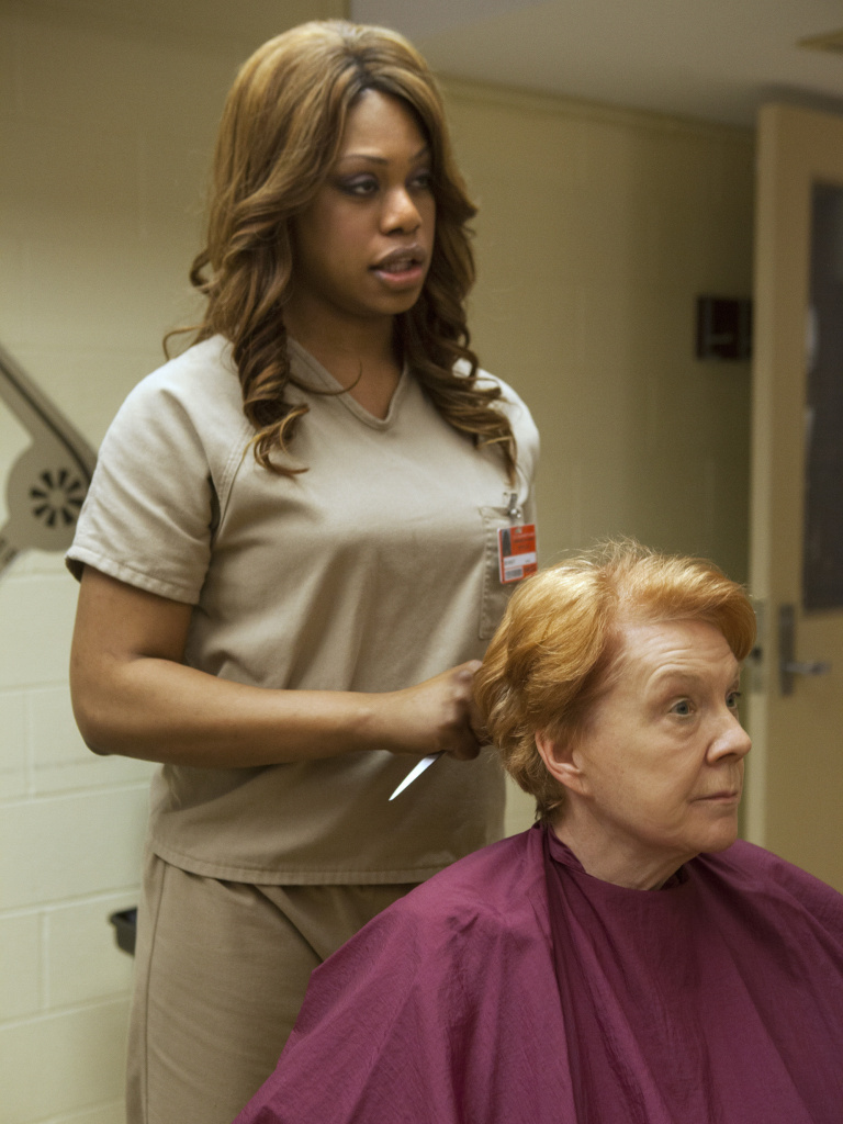 "Laverne Cox, left, plays Sophia, a transgender character in Netflix's ""Orange is the New Black."""