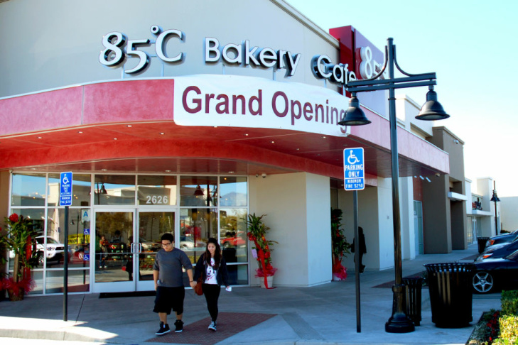 WEST COVINA, Calif. -- Customers emerge from the storefront at the new 85°C Bakery Cafe on Jan. 16. This West Covina store is the third location to open in the United States. While new to the U.S. market, this Taiwan-based chain has more than 700 stores worldwide.