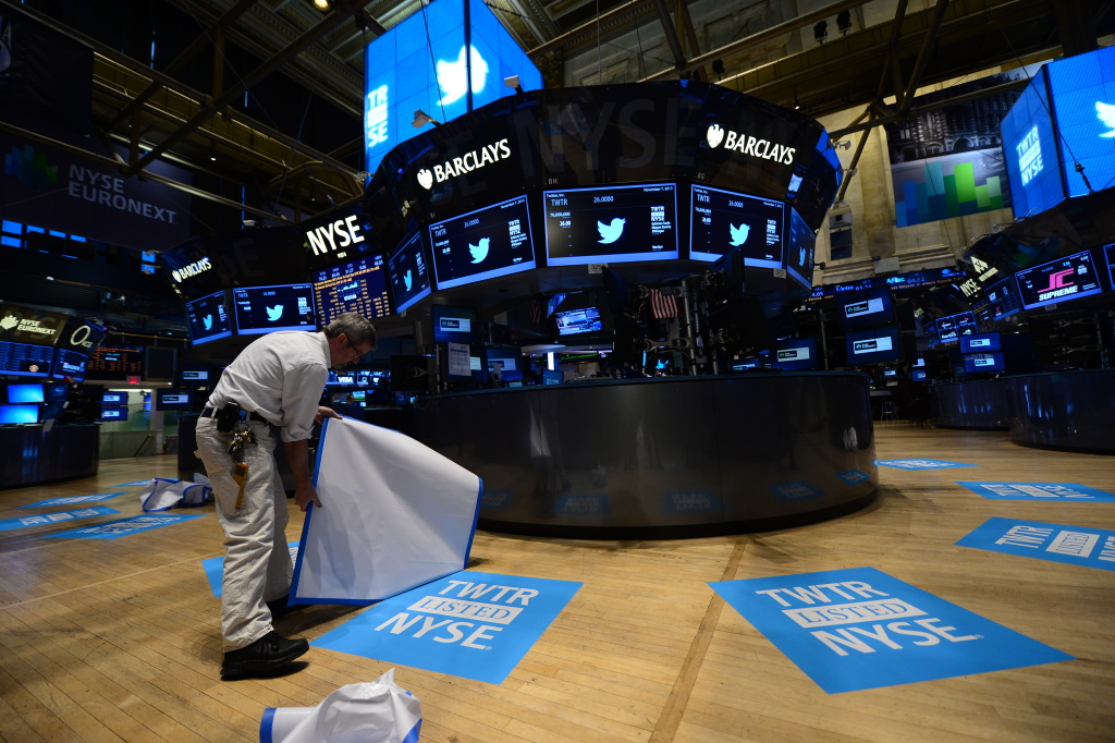 A worker unveils floor mats bearing the logo of Twitter and the symbol on which Twitter's stock will traded (TWTR) on the floor of the New York Stock Exchange (NYSE) on November 7, 2013 in New York. Twitter goes public on the NYSE today,and is expected to open at $26 per share, making the company worth an estimated 18 billion USD.