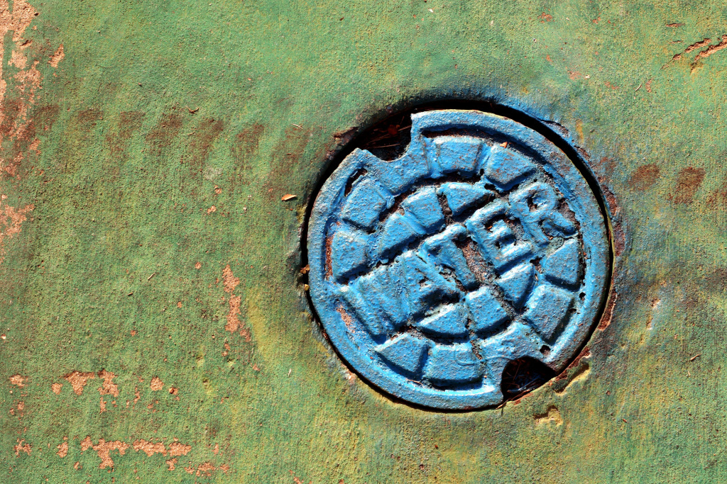 A grant will help 20 cities and the county of Orange clean polluted waterways including drains.
