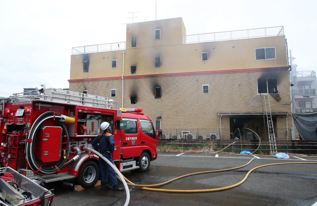 A fire fighter watches an animation company which caught fire in Kyoto on July 18, 2019.