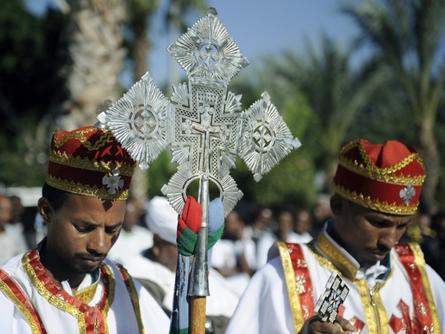 Eritrean Christians lead a memorial service in Tel Aviv in October in honor of victims of the Lampedusa, an immigrant boat shipwrecked off Italy in October. The number of African Christians in Israel is rising.