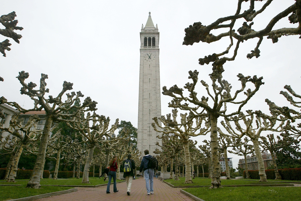 Students walk near Sather Tower on the University of California at Berkeley campus in Berkeley, California.