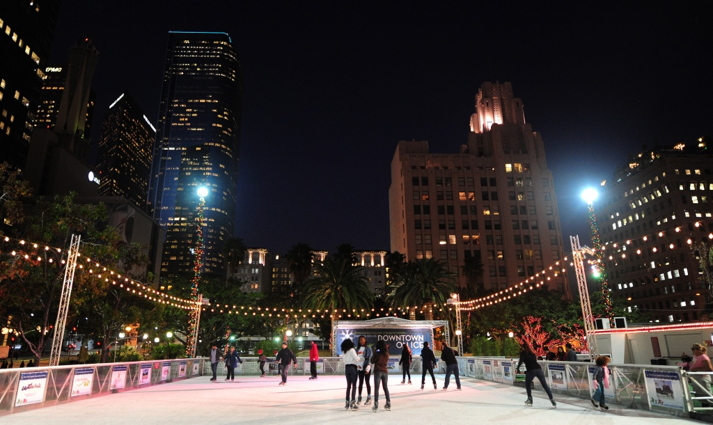 Skaters take to the ice at an outdoor rink beneath office towers in downtown Los Angeles, on November 21, 2011. The rink opens for the 2017-2018 season on Thursday.