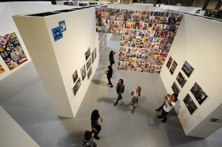 A work (upper left hand corner) by French street artist Space Invader is on display at the 'Art In The Streets' exhibtion inside the Museum of Contemporary Art (MOCA) in Los Angeles on April 21, 2011.