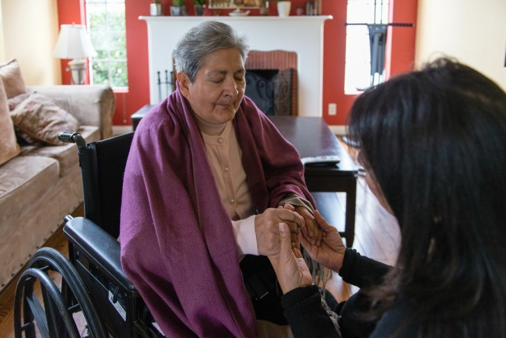 Tania Yanes sits with her mother, Blanca Rosa Rivera, in her living room in North Hollywood.