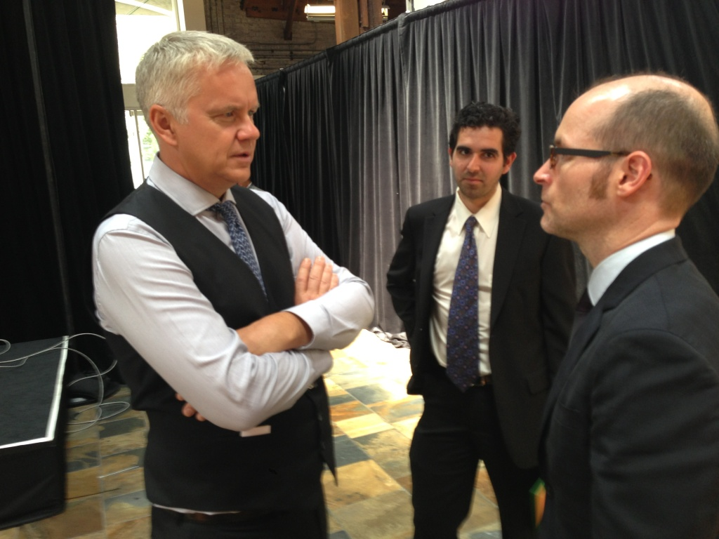 Actor Tim Robbins, left, talks about the participation of his Actors' Gang group in the Los Angeles Promise Neighborhood project with Dixon Slingerland, right, Executive Director of Youth Policy Institute.