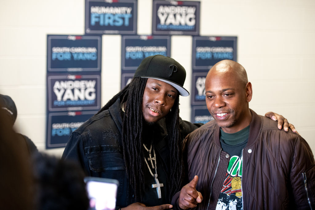 Comedian Dave Chappelle poses for a photo with a potential voter while campaigning for Democratic presidential candidate Andrew Yang on January 30, 2020 in North Charleston, South Carolina.