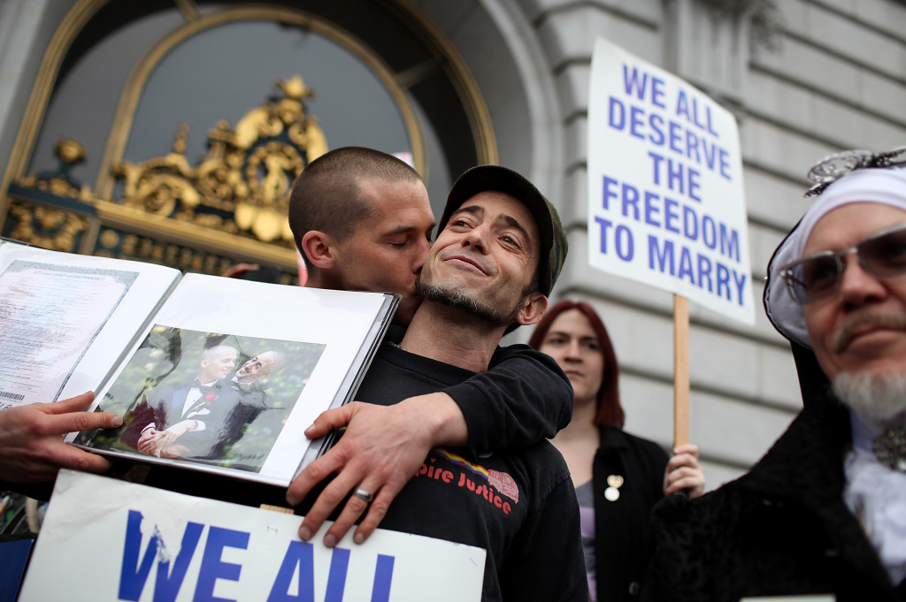 Frank Capley-Alfano (L) and Joe Capley-Alfano kiss as they celebrate outside of San Francisco City Hall on February 7, 2012 in San Francisco, California. A three-judge panel of the 9th U.S. Circuit Court of Appeals ruled that the voter-approved Proposition 8 measure violates the civil rights of gay men and lesbians.