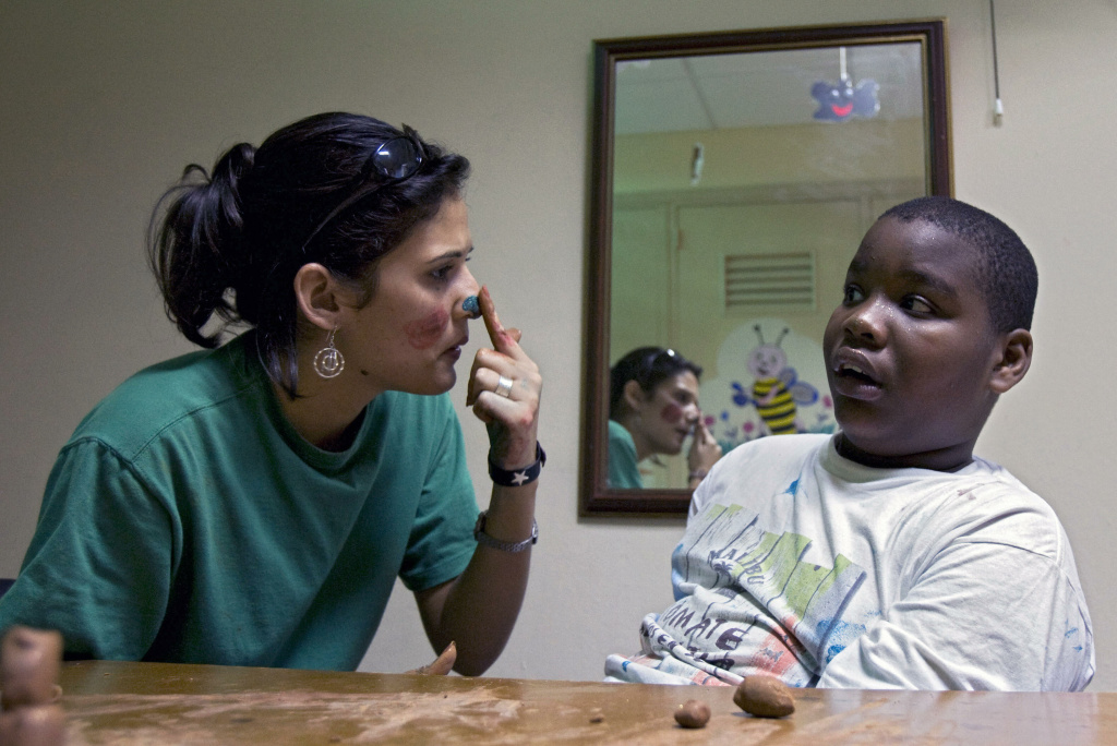 Therapist and Art teacher Anais Cheong (L) instructs autistic child Noel Cabrera at Dora Alonso Special School, on February 11, 2008, in Havana.