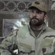 "A publicity image of Bradley Cooper in ""American Sniper."""