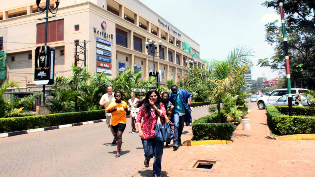 People run from the Westgate Mall in Nairobi, Kenya, on Saturday, after gunmen attacked with grenades and gunfire. At least 20 people are reported to have died in the attack.