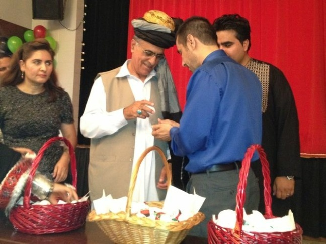 Afghan instructors demonstrate how to play a game called