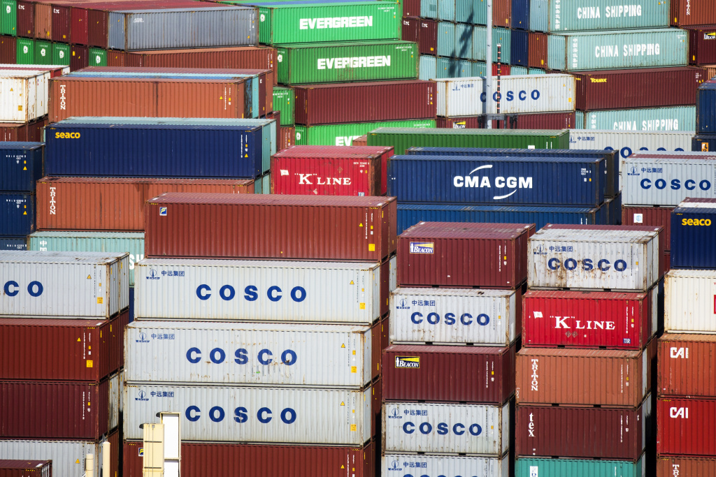 Cargo ships are loaded at the Ports of Los Angeles and Long Beach on Friday, Feb. 19, 2016.