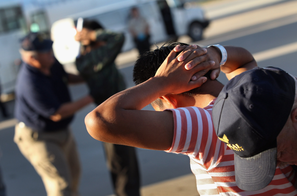 MESA, AZ - JUNE 24:  Undocumented Guatemalan immigrants are body searched before boarding a deportation flight to Guatemala City.