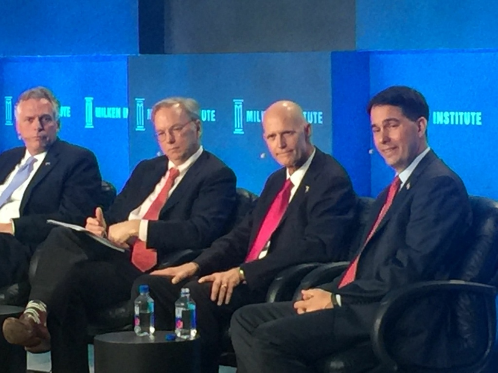 Florida Governor Rick Scott (second from the right) speaks on a panel at the 2016 Milken Global Conference.