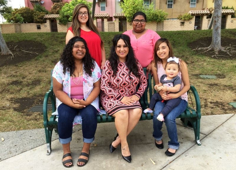 Mayor Ramona Padilla (C) meets with young women in Lindsay, to urge them to vote.