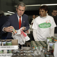 US President George W. Bush grabs a can of peaches