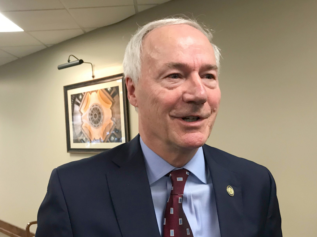 Arkansas Gov. Asa Hutchinson on Tuesday signed into law a bill banning nearly all abortions in the state, a sweeping measure that supporters hope will force the U.S. Supreme Court to revisit its landmark <em>Roe v. Wade</em> decision.