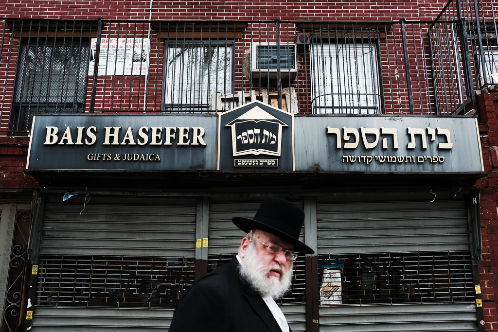 A Hasidic man walks through a Jewish Orthodox neighborhood in Brooklyn on April 24, 2017 in New York City. According to a new report released by the Anti-Defamation League (ADL), anti-Semitic incidents in the U.S. rose by 86 percent in the first three months of the year. The group's audit of anti-Semitic events counted 541 anti-Semitic attacks and threats in the first quarter of the year, a significant increase over the same period last year.