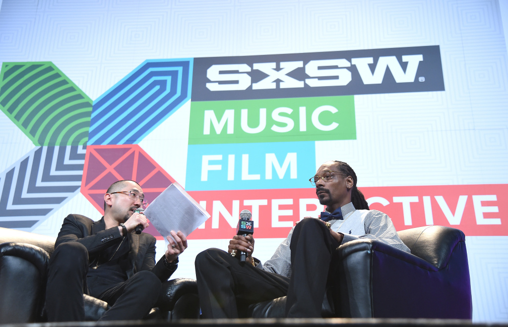 Manager Ted Chung (L) and Recording artist Snoop Dogg speak on stage at the Snoop Dogg Keynote during the 2015 SXSW Music, Film + Interactive Festival at Austin Convention Center on March 20, 2015 in Austin, Texas.