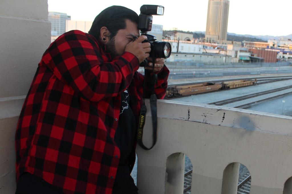 Citlalli Lopez, 15, focused on photographer Elmer