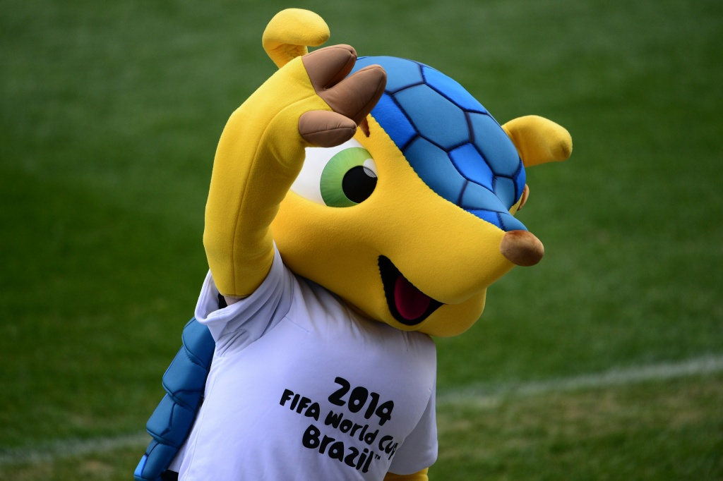 Official mascot of the 2014 FIFA World Cup Brazil Fuleco the Armadillo waves during a training session of Italian football team at the Vicente Calderon stadium in Madrid on March 4, 2014 on the eve of their World Cup 2014 friendly football match against Spain.