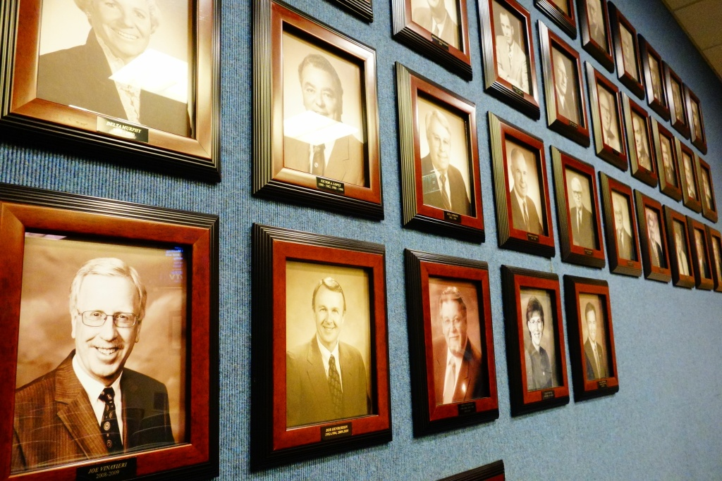 The back wall of the Whittier City Council chambers is lined with photos of past mayors and council members, only one of whom has been Latino in the city's 115-year history. The city's population is two-thirds Latino.