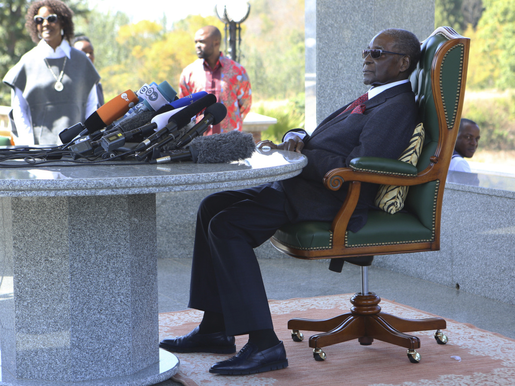 Former Zimbabwean President Robert Mugabe holds a press briefing at his residence on Sunday, July 29, 2018, on the eve of the country's all important elections.