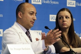 Emily Fennelll, who lost her right hand in an auto accident in 2006, listens as Dr. Kodi Azari, surgical director of the UCLA Hand Transplantation Program, describes Fennell's surgery at a news conference at UCLA Medical Center on April 19, 2011.