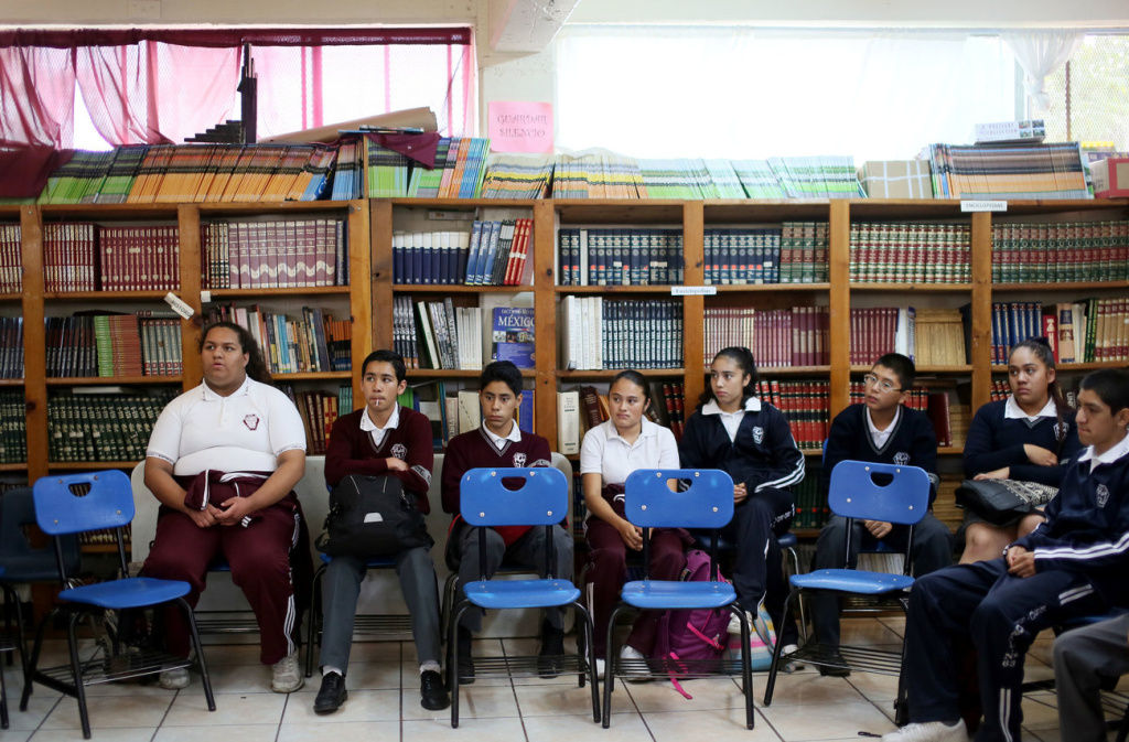 Recent arrivals sit in class at the Eucario Zavala Secondario 63 school in Tijuana, Mexico.