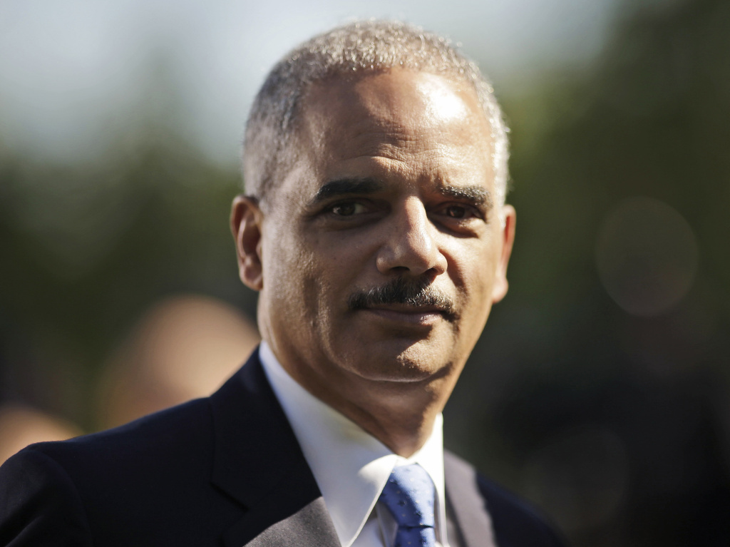 In this file photo from Oct. 2013 he attends the announcement of Jeh Johnson as the next Homeland Security Secretary. The Justice Department reported Thursday that Holder had been taken to the hospital after complaining of faintness and shortness of breath.