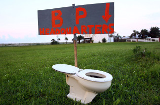 A sign left by the side of the road points to a toilet on May 30, 2010 near Grand Isle, Louisiana.
