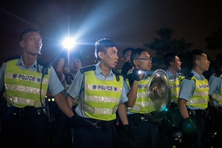 Police officers advance on pro-democracy protesters in Hong Kong