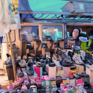 A woman waits for customers at a street market where she sells shoes in Sao Paulo, Brazil. Brazil and other Latin American economies have prospered by selling commodities and low-tech goods. But now many economies are struggling, and some point to the region's lack of high-tech and other cutting edge industries.